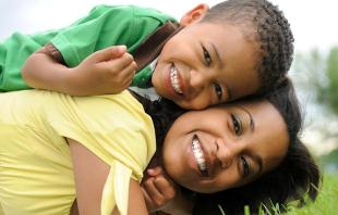 Black Mom and Son In Grass