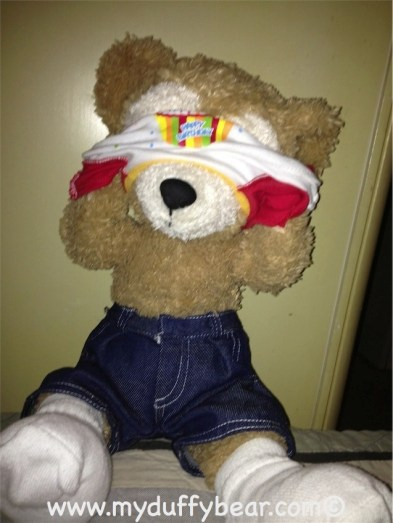 Duffy the Disney Bear's tee shirt gets stuck on his head