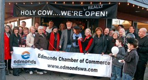 "Mayor Dave Earling joined representatives of Bill the Butcher at the Edmonds Chamber of Commerce ""ribbon chopping"" Friday afternoon. To celebrate, the store offered grilled meat samples and prizes. Bill the Butcher is located at 323 Main St. in downtown Edmonds."