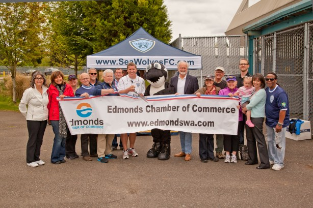 Sammy, the North Sound SeaWolves mascot, is flanked by the premier development soccer team's general manager Jim Underhill and head coach Ed Moore, on left, and Edmonds Mayor Dave Earling, right, plus members of the Edmonds Chamber of Commerce during the team's ribbon cutting Saturday afternoon.