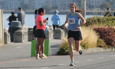 E-W assistant cross country coach Kate Nishino placed second in the women's division.