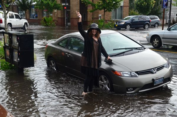 Colleen Taylor of Poulsbo was in the Red Twig for the Thursday open mic night when the storm hit.  She waded out to check on her car, which was up to the axles in water. (Larry Vogel photo)