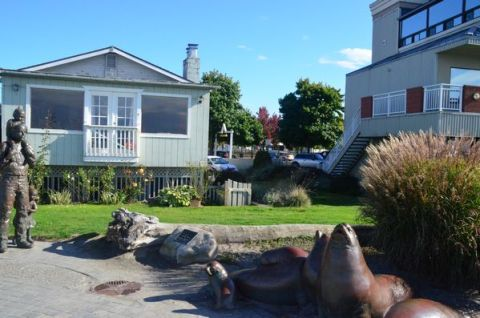 The site viewed from the beach shows the house on the left, the existing access path in the center, and the Edmonds Bay Building on the right.