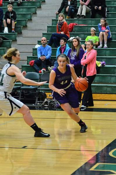 Sydney Peterson drives the lane against the Timberwolves.