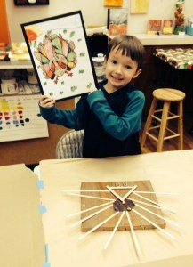 Noah displays his Autumn Colors Turkey and his abstract multimedia piece, The Turkey.