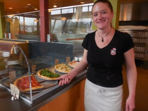 Adria Ferris, Pagliacci general manager, and the new slice bar.