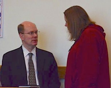 Rose Adams confers with her court-appointed attorney John Rongerude prior to her sentencing.