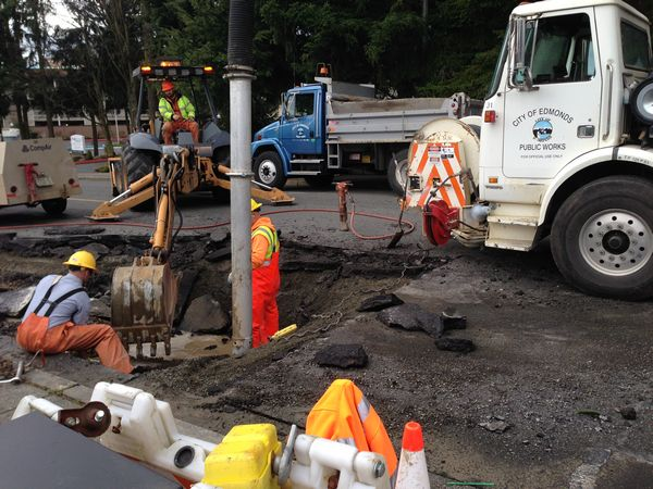 Edmonds Public Works crews were hard at work Wednesday morning repairing a water main break in the 21400 block of of 72nd Avenue West, behind Value Village on Highway 99. Here, crews are breaking up concrete and using the big vactor truck to pump the water out.