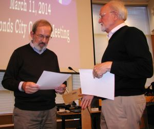 Immediately after his appointment, Mesaros receives instruction from Mayor Dave Earling before being sworn in.