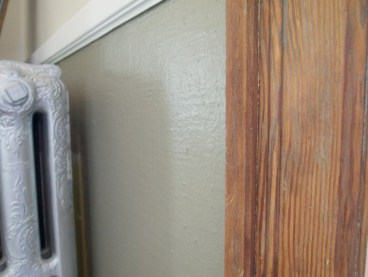 Close-up of original fir trim surrounding in upstairs entry.