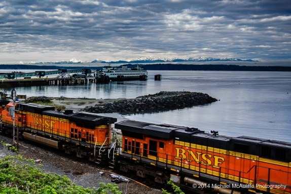 From Mike McAuliffe,  a train and a ferry on the Edmonds waterfront as the sun was starting to shine on the Olympic Mountains Monday morning.