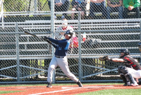 Meadowdale's Jacob Hunnewell hits a double in the 2nd inning of their game against Mountlake Terrace on  4-25-14