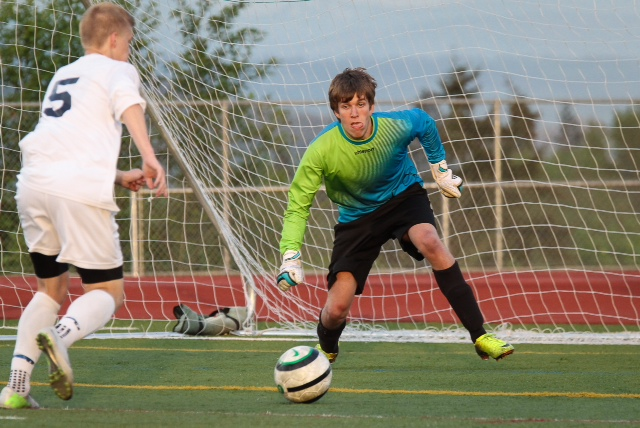 Meadowdale goalie Mark Steinke defends against Glacier Peak forward Riley Prescott during Meadowdale's 2-1 playoff win on Thursday, May 15. The Meadowdale (11-6-2) faces Marysville-Pilchuck (10-9) in a winner-to-state/loser-out 3A tournament game at 5 p.m., Saturday, May 17 at Shoreline Stadium. The Mavericks beat the Tomahawks 2-1 during the regular season. (Photo by Michael Bury)