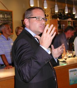 Strom Peterson speaks to supporters Tuesday night at Arista Wine Cellars.