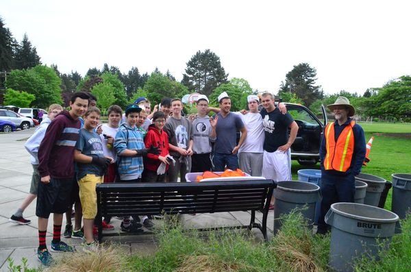 The group gathered promptly at 9 a.m. to meet with Edmonds Parks Department horticulturalist Jesse Curran (right), who oversaw their morning's project of clearing a weed-infested area near the parking lot.