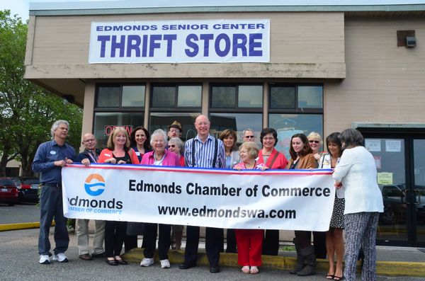 Edmonds Senior Center and Edmonds Chamber of Commerce members gathered for the ribbon cutting as the Senior Center Thrift Store reopened Wednesday morning.  The store had been closed for 10 days while new flooring was installed and fresh paint applied to the walls.