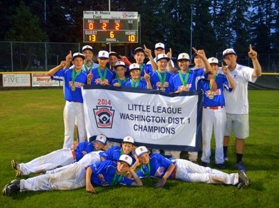 With the winning score in the background, the Pacific Little League All-Star team poses after their victory. (Photo courtesy Pacific Little League)