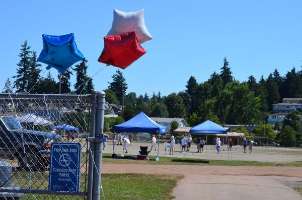 The red, white and blue of the French Tricolor was very much in evidence Sunday morning as the Edmonds Petanque Club took over the Civic Stadium for the annual tournament.  The sport of Petanque originated in France, and the Edmonds Club's annual event is timed to coincide with Bastille Day, which marked the beginning of the French Revolution and according to historians, the dawn of the modern era of European history.