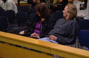 Rose Adams and George Beutler hold hands at their May 2013 arraignment.