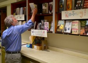 Edmonds Rotary Club member Pat Shields checks out the donated books.