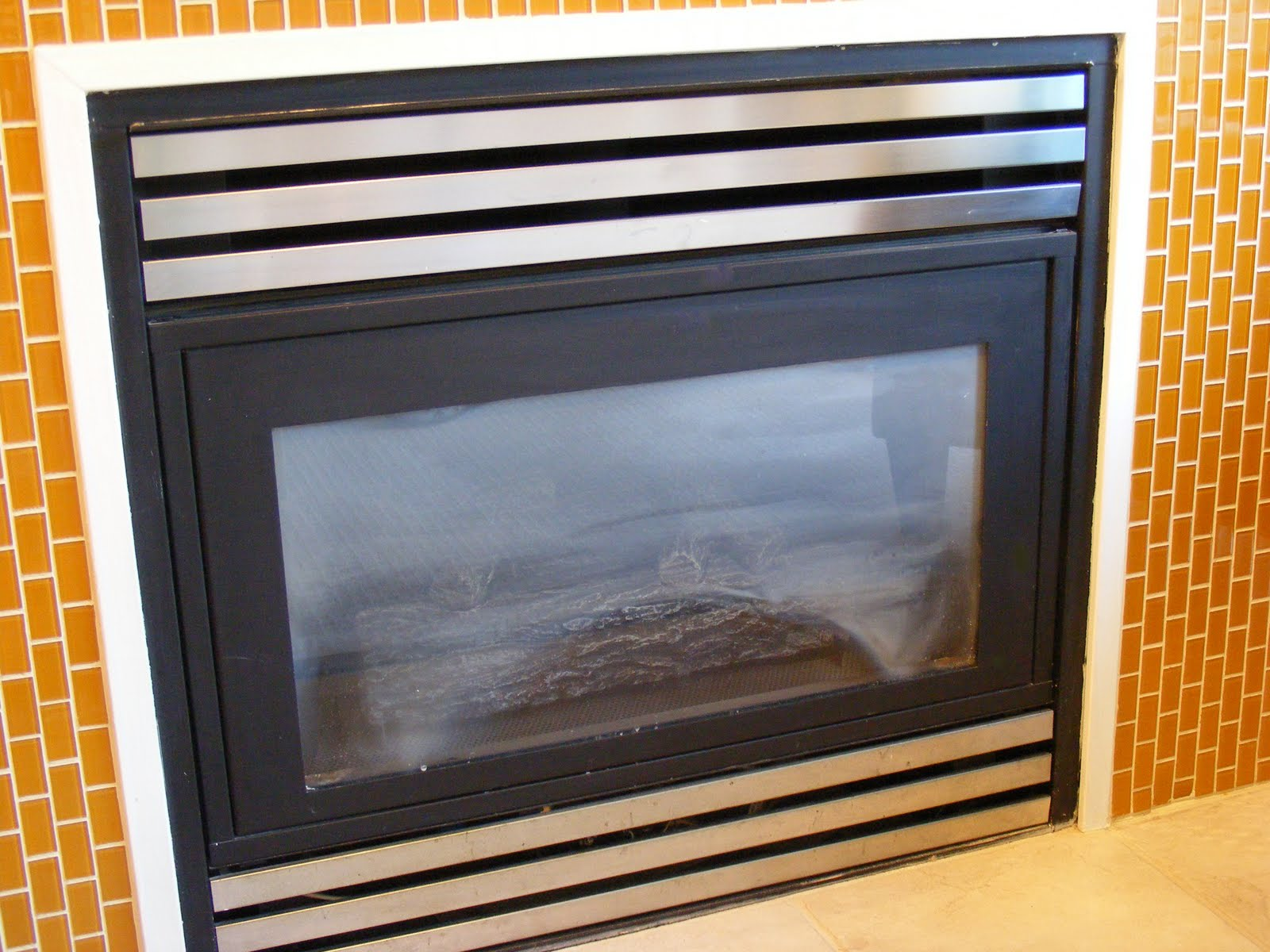 Cleaning A Fireplace Dirty Glass Other Maintenance Items Mygasfireplacerepair