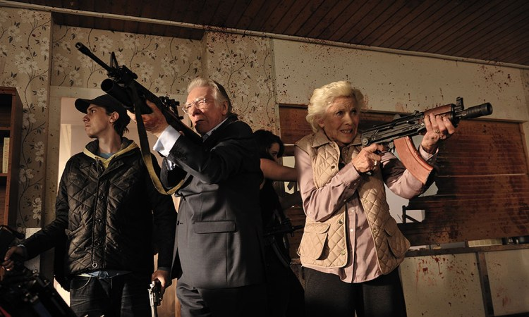Alan Ford and Honor Blackman make a stand against the zombie invasion.