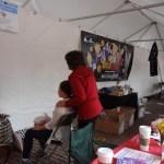 Boston Japan Festival 2013 - Maxine adminstering Reiki to patron