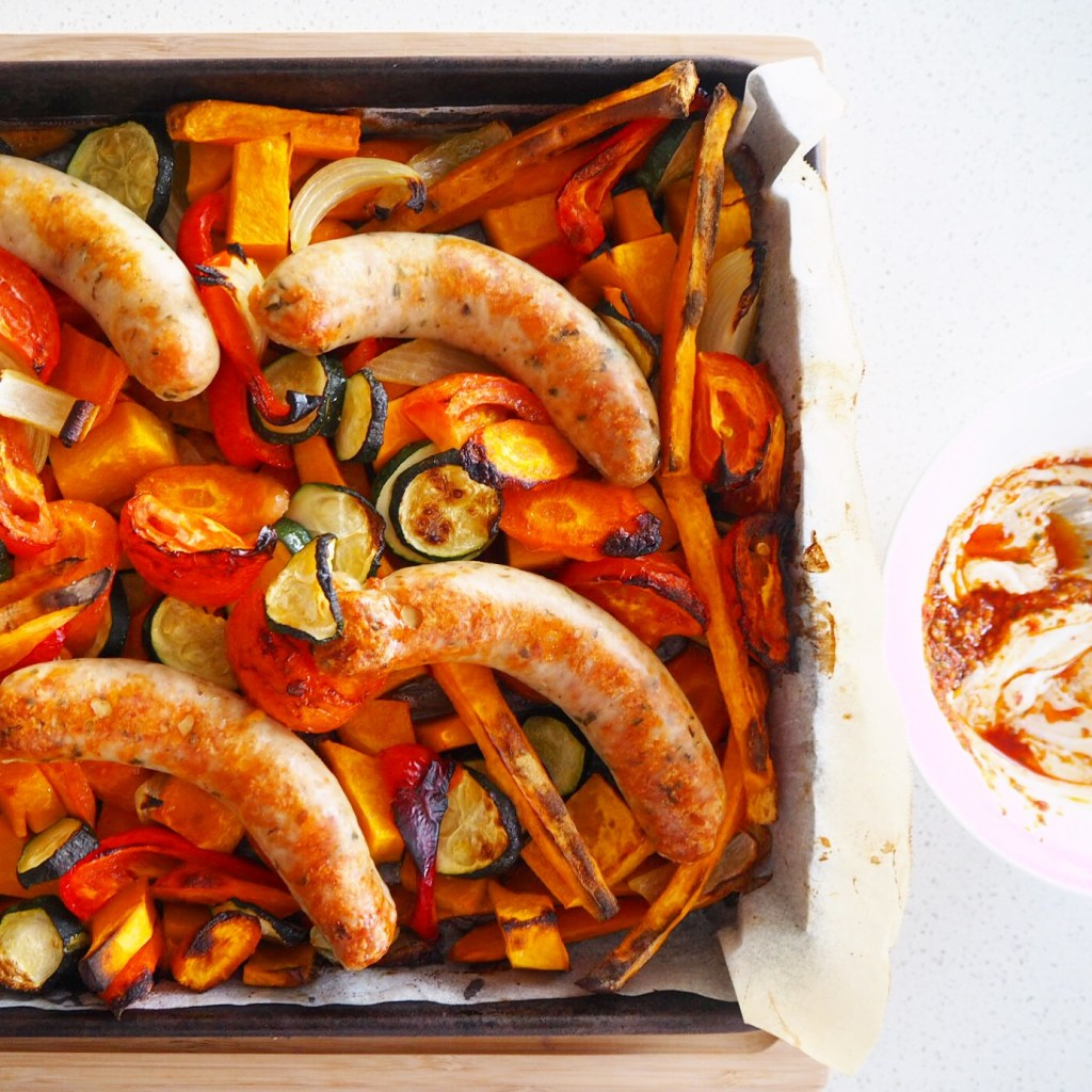 chicken sausage tray bake with pesto swirled yoghurt
