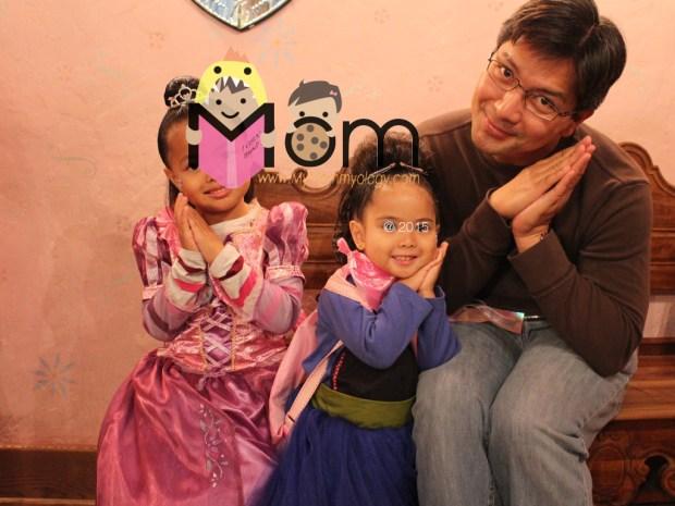 Dad and his happy princesses.