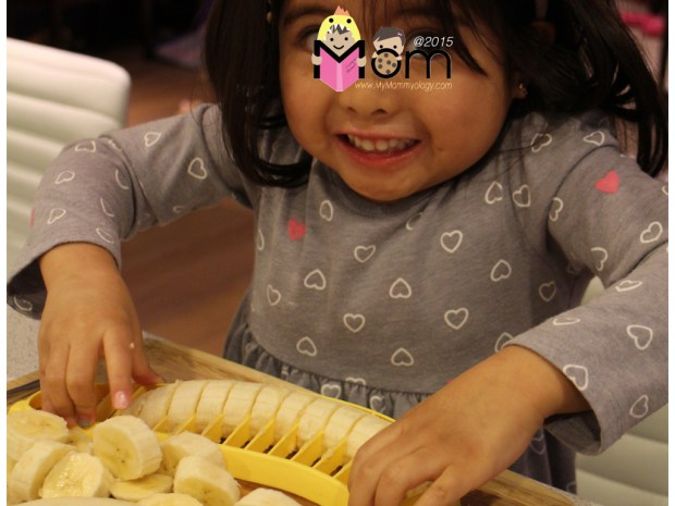 Happily cutting and mashing bananas for our home made banana bread.