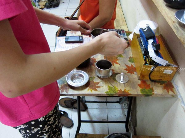 Tasting brewed coffee from coffee beans we were considering buying