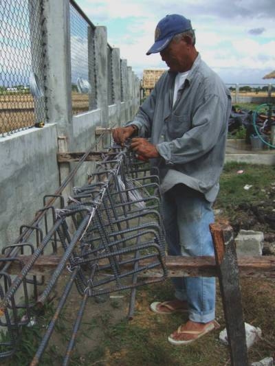 Foreman Tatoy fabricating rebar cage to reinforce our corner columns