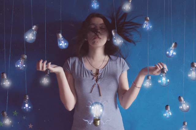 Girl conceptual portrait photograph with bulbs