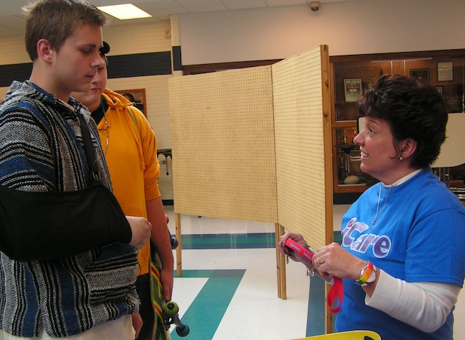 Cindi Schweitzer, founder of iCare, asks a student at the Heroin Summit at Waterford Union High School in May to promise to visit the iCare website and educate himself on the area's drug problem and how he can help.