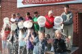 From left: Hair stylists Linda Reiherzer, Sue Nelson, Red Smetana, Linda Vos, Linda Weidner and Tina Czuta participate in the Ice Bucket Challenge Tuesday evening at Nelson's Mane Concern in Burlington. Pouring the ice water were: (back from left) John Reiherzer, Ken Nelson, Erin Nelson, Justin Mushel, Tater Weidner and Jarmen Czuta. (Photo by Jennifer Eisenbart)