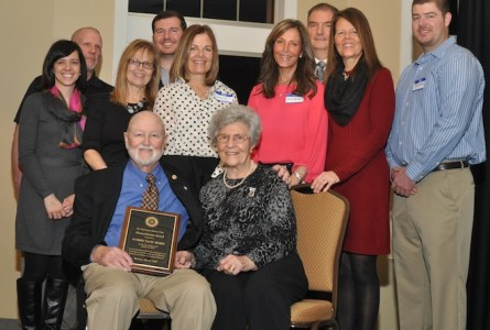 Burlington Rotary Club Humanitarian Award winner Jack Berry (seated, left) gathers with his wife, Ruth, and members of his family following a ceremony at Veterans Terrace Monday. On hand for the celebration are (from left) Gretchen Hoffman, Rich Cable, Kathy Cable, Kyle Hoffman, Leslie Fry, Jackie Spradley, Scott Hoffman, Marilee Hoffman, Jason Hoffman. (Photo by Ed Nadolski)