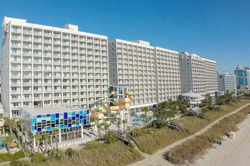 View from the Beach - Back side of the Crown Reef Resort Myrtle Beach South Carolina, Water Park with Water Slides
