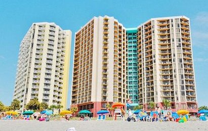 View of the back of the Patricia Grand Resort in Myrtle Beach from the sand