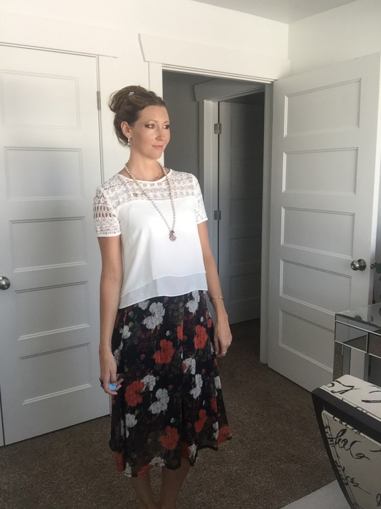 white lace shirt and floral midi skirt