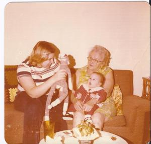 My mom, Aunt Amy holding me