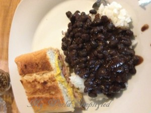 Black Beans served over rice with a Cuban sandwich