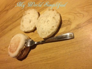 cutting english muffin with a fork