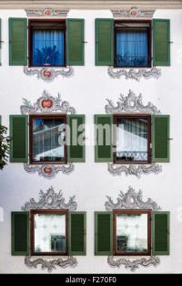 Typical germany windows with green shutters and window box ...