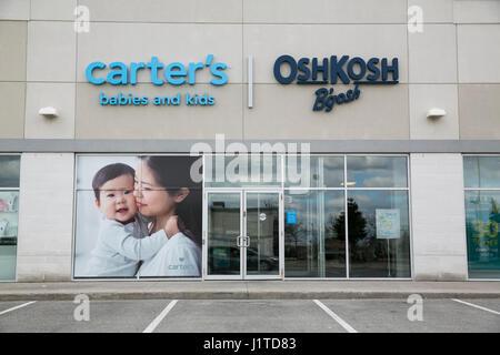 A logo sign outside of a Carter\u0027s, Inc, and OshKosh B\u0027Gosh retail - carters inc
