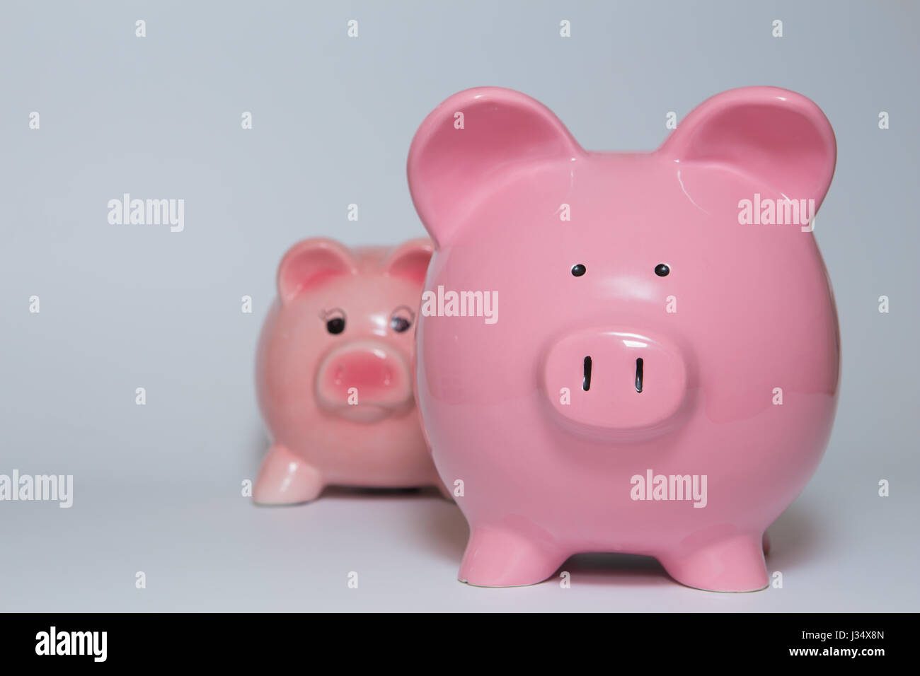 Pink Plastic Piggy Banks Big Piggy Bank Little Piggy Bank Stock Photos And Big Piggy