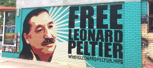 Artist Greg Deal's Leonard Peltier mural at the Albuquerque, NM Peace and Justice Center, headquarters for the Peltier Defense Committee (photograph courtesy of therednation.org).