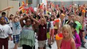 Torches held high, NAES first graders enjoy the Opening Ceremony