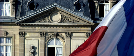 France, Paris, Elysee Palace, French flag in foreground, close-up