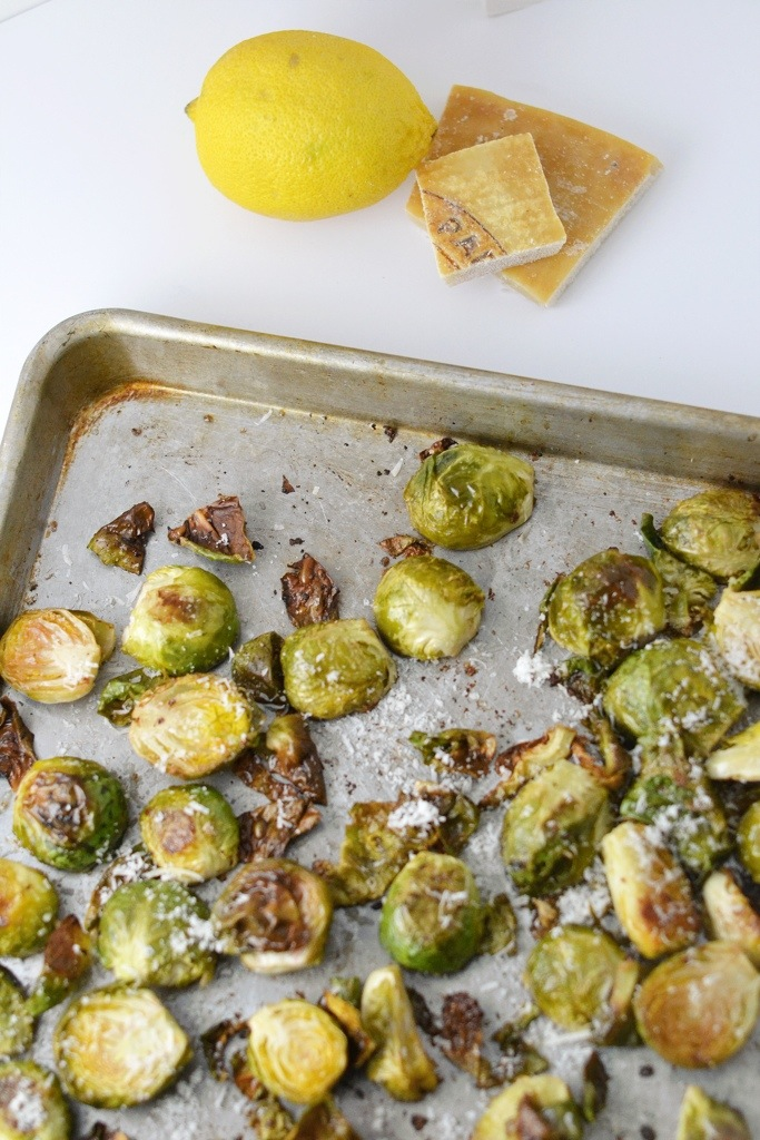 Generously top the hot brussel sprouts with Parmesan. Then serve ...