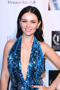 Actress Natasha Blasick on the red carpet wearing one of her own designs